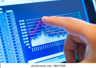 business chart on a touch screen tablet-pc