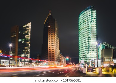 Business city center in Berlin at night. Modern office buildings on Potsdamer Platz in Berlin. Long exposure photo. City street with night illumination