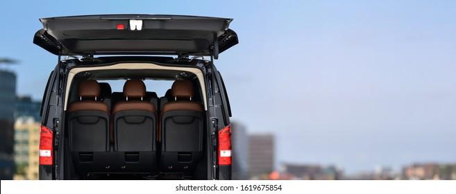 Business Class Passenger Van with Open Trunk Door