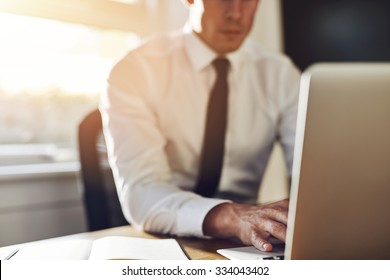 Business close up, executive working on laptop while sitting at office