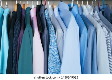 Business clothes Shirts in home closet wardrobe, blue colours