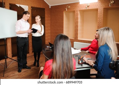 Business coach holding training for staff