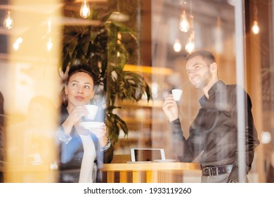 Business coleagues having a coffee at a cafe bar