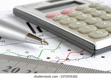 Business collage with pen, graph and calculator.