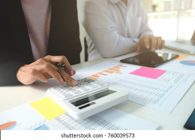 Business colleagues analysis data document with accountant using calculator