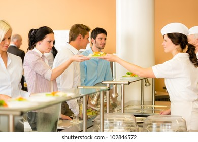 Business colleagues in cafeteria lunch-lady serve fresh healthy food meals
