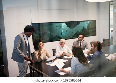 Business colleagues in conference meeting room during presentation