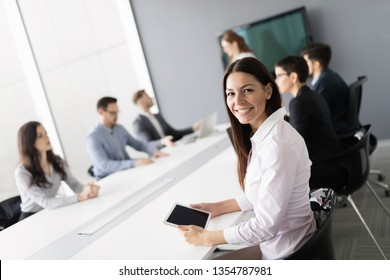 Business colleagues in conference room working together