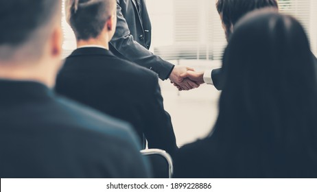 business colleagues greeting each other with a handshake
