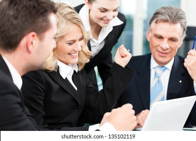 Business - colleagues have a successful meeting in an office