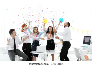 Business colleagues having party at office