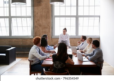 Business colleagues at meeting looking to female manager