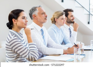 Business colleagues sitting together in meeting at office