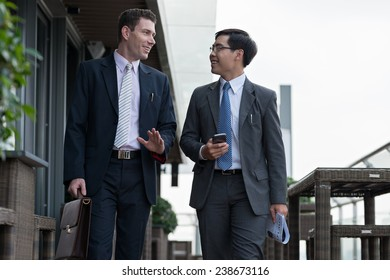 Business colleagues talking while going to work