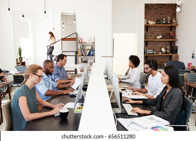 Business colleagues working at a busy open plan office