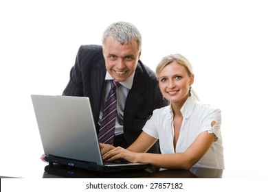 Business colleagues working on laptop together