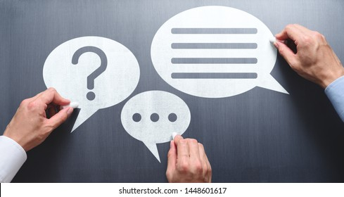 Business communication breakdown concept. Lack of communication skills. Businessmen drawing speech balloons on chalkboard.