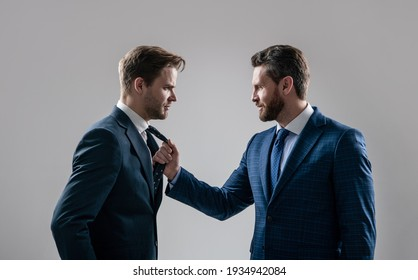 business competition. businessmeeting. struggle for leadership. displeased colleague dispute. negotiations. businessmen talking and discussing conflict. boss and employee. disagreed men partners.