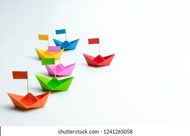 Business competition concept with Colorful paper ships on white background - Shutterstock ID 1241265058
