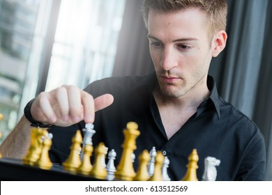 business competition concept with man playing chess game board