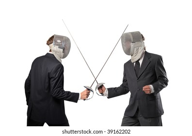 business competition concept: two businessmen in fencing suit with sword