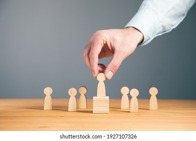 Business competition and Leadership concept with wooden figures