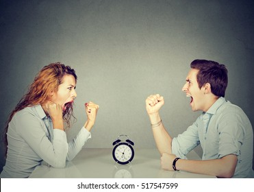 Business competition. Man and woman mad and angry with each other having disagreement screaming