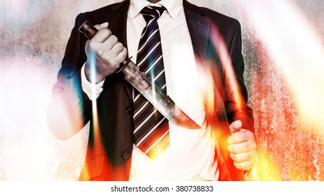 Business competition,Businessman bring out knife ready to fight or protect business.