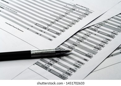 Business composition. Financial analysis - income statement sheet, business plan with pen. Investment portfolio