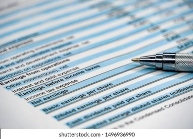 Business composition. Financial analysis - income statement, business plan with pen