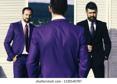 Business and compromise concept. Leaders have business meeting. Managers wear smart suits and ties on wooden wall and nature background, defocused. Men with beard and convinced faces discuss business
