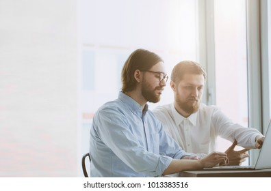 Business comunity. Two young working  businessmen
