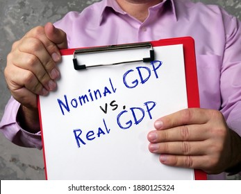Business concept about Nominal GDP vs. Real GDP gross domestic product with sign on the sheet.