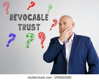 Business concept about REVOCABLE TRUST question marks with sign on the gray wall