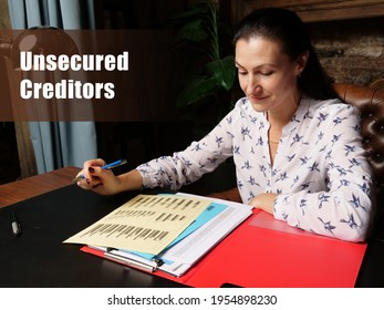 Business concept about Unsecured Creditors Businesswoman, executive manager hand filling paper business document - Shutterstock ID 1954898230