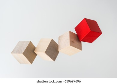 Business concept - Abstract geometric real floating wooden cube on grey background and it's not 3D render. the symbol of leadership, teamwork and growth.