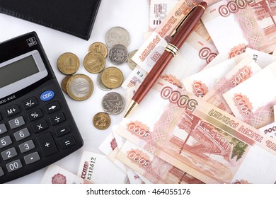 Business concept. Accounting. Russian rubles banknotes, pen notebook and calculator top view