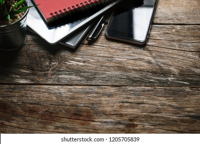 Business concept with agenda, mobile Phone,Tablet and calculator. Copy space Creative studio concept