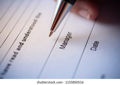 Business concept of agreement. Manager signing agreement or contract form