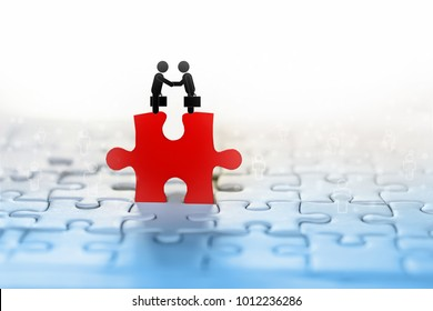 business concept background with two businessman handshake icon on red jigsaw with people connection in background idea for teamwork,support and partnership