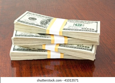 business concept. big stack of money over table