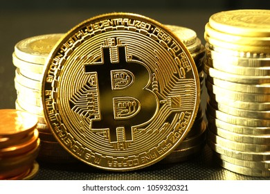 Business concept, bitcoin with coin stacks background