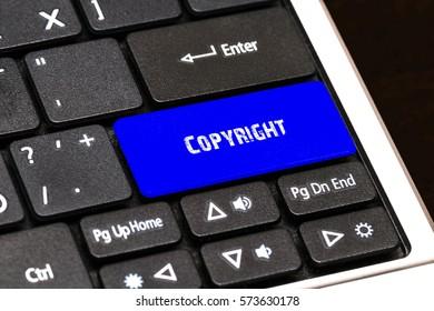 Business Concept - Blue Copyright Button on Slim.