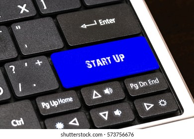 Business Concept - Blue Start Up Button on Slim.