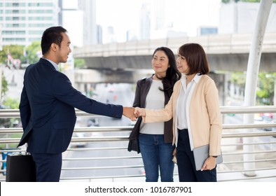 Business concept, Businessman and businesswomen are shaking hands after meeting plan.