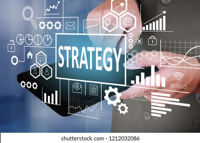 Business Concept. Businessman click strategy button on his tablet. Goals Text typography design