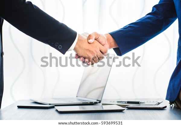 business concept, businessman handshake in office workspace for investment