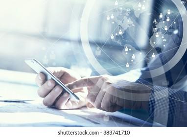 Business concept. Businessman working generic design laptop. Touching screen smartphone. Worldwide connection technology interface. Horizontal closeup