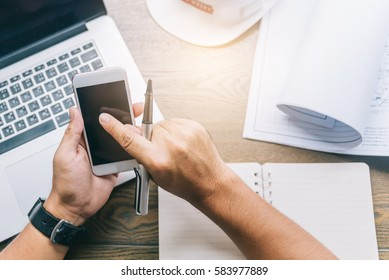 business concept, businessman working on workspace with smartphone