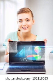 business concept - businesswoman showing laptop with graph